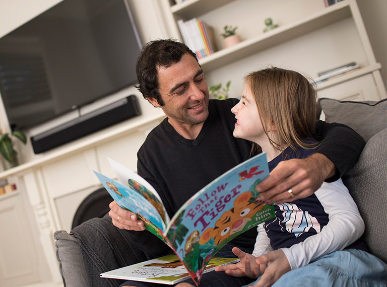 father and daughter reading together