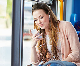 Girl on bus using mobile device