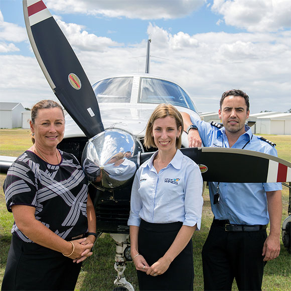 Gina Williams, from Newcastle Permanent, with Little Wings CEO Richelle Koller and pilot James Groves.