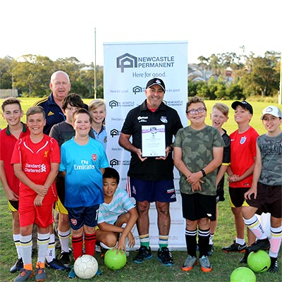 Newcastle coach of the month Stan Patinotis with some of his young players