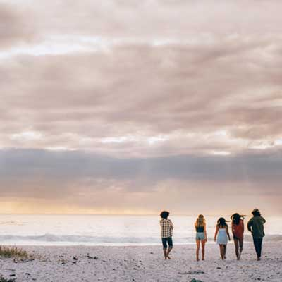 Group of people walking on the beach