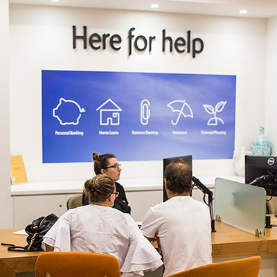 Customers being helped in branch