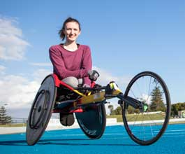 Girl in wheelchair on athletics track